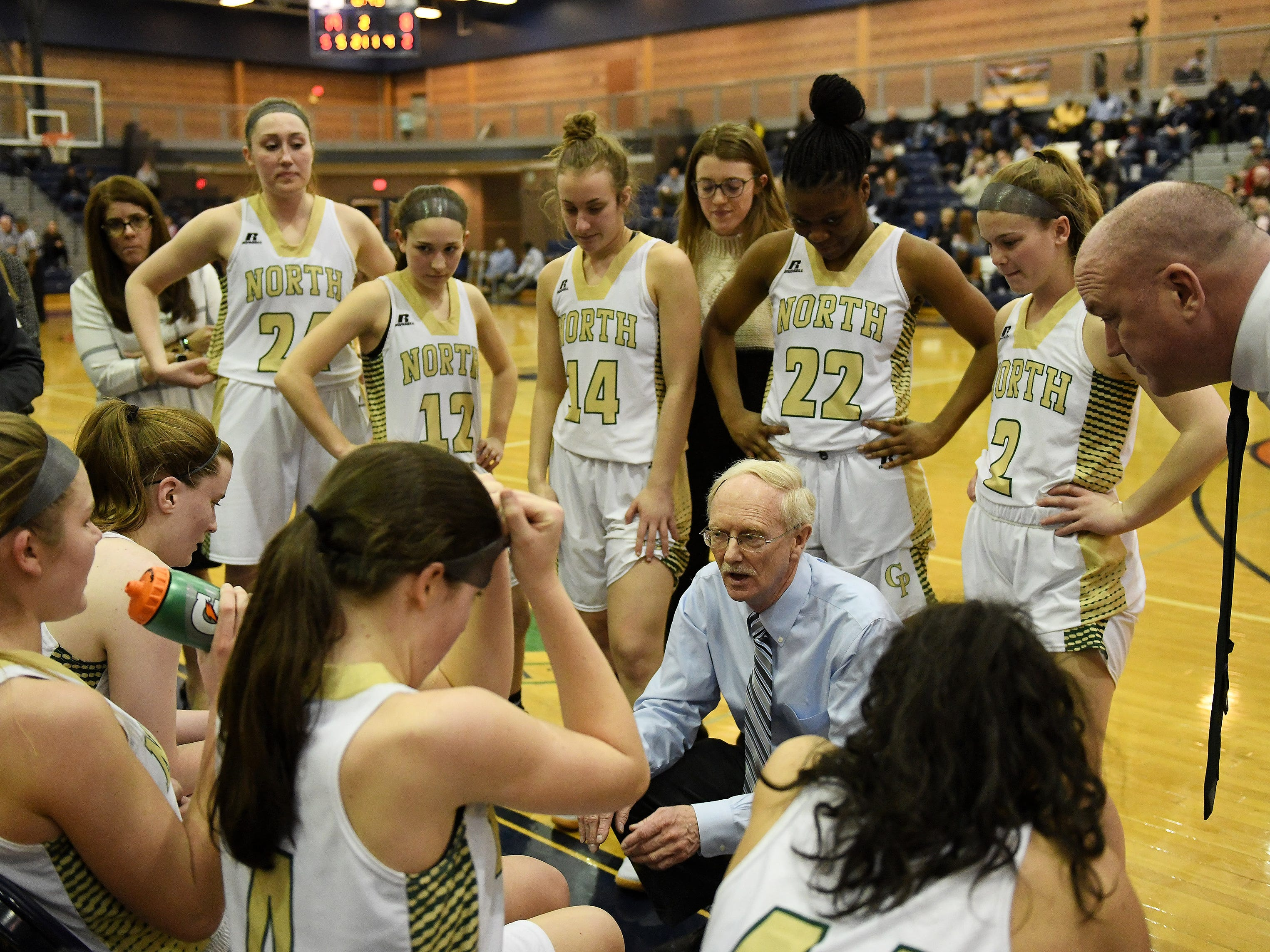 Grosse Pointe North coach Gary Bennett talks with his team in the first half.