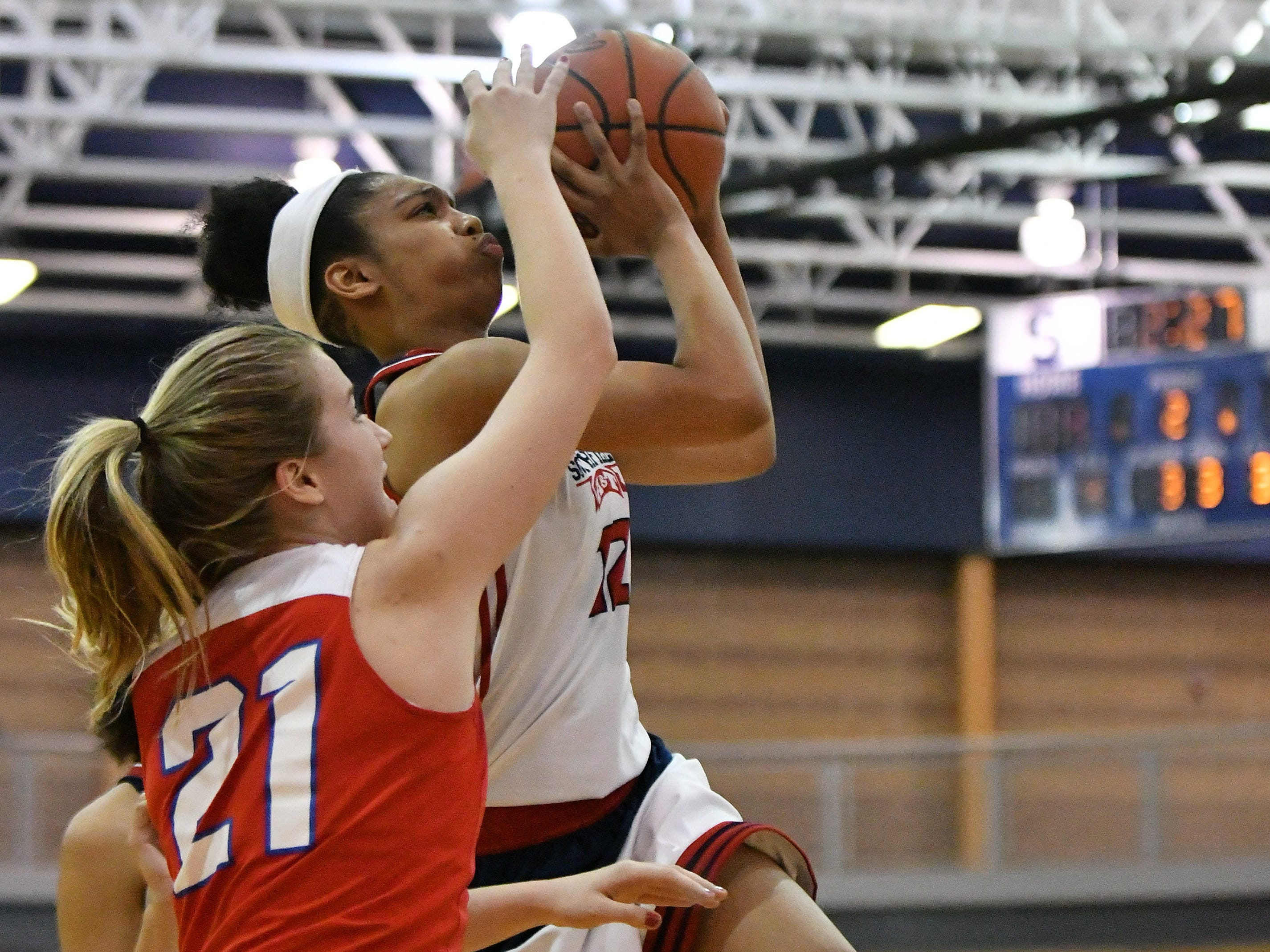 Warren Cousino's Olivia Joliffe (21) defends a shot by Southfield A&T's Cheyenne McEvans in the first half.