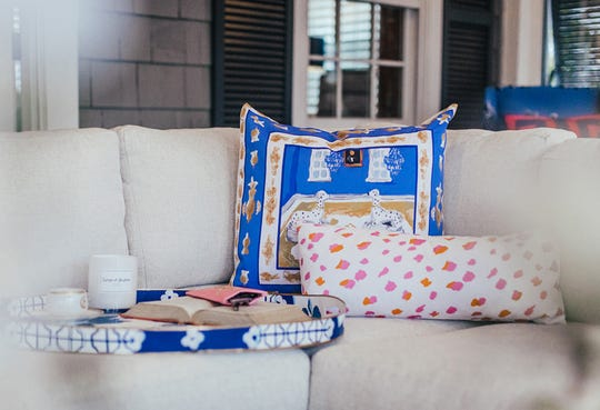 Take time to relax with your favorite things. These Dana Gibson pillows and tray offer the perfect spot to get cozy. (Handout/TNS)