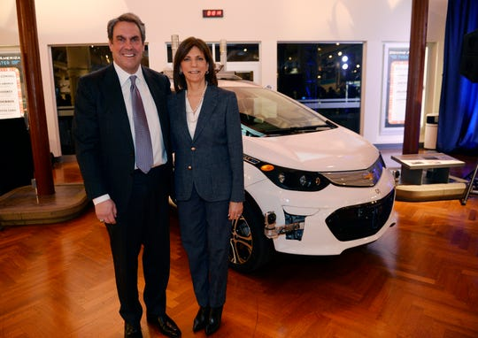 Mark Reuss, president of General Motors, and Patricia Mooradian, president and CEO of The Henry Ford, stand next to the 2016 Chevrolet Bolt EV, the first-generation self-driving test vehicle, which is joining the museum's collection.