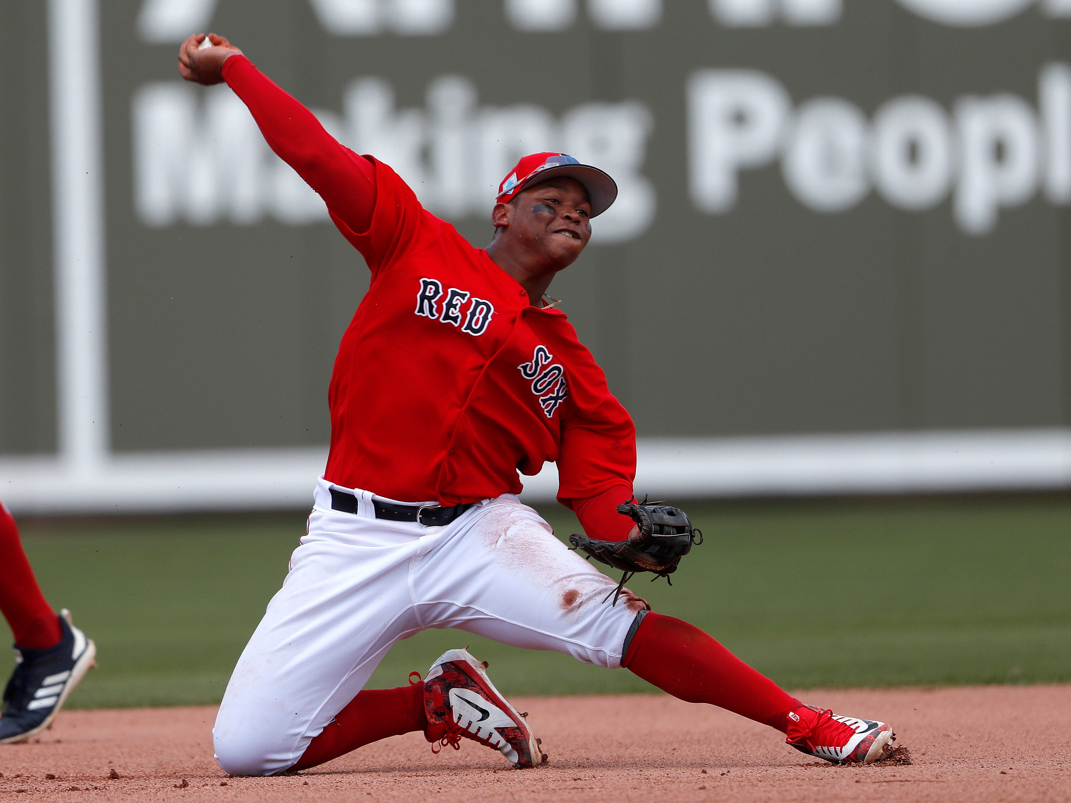 Boston Red Sox third baseman Rafael Devers throws out Detroit Tigers' Niko Goodrum at first base in the fifth inning.