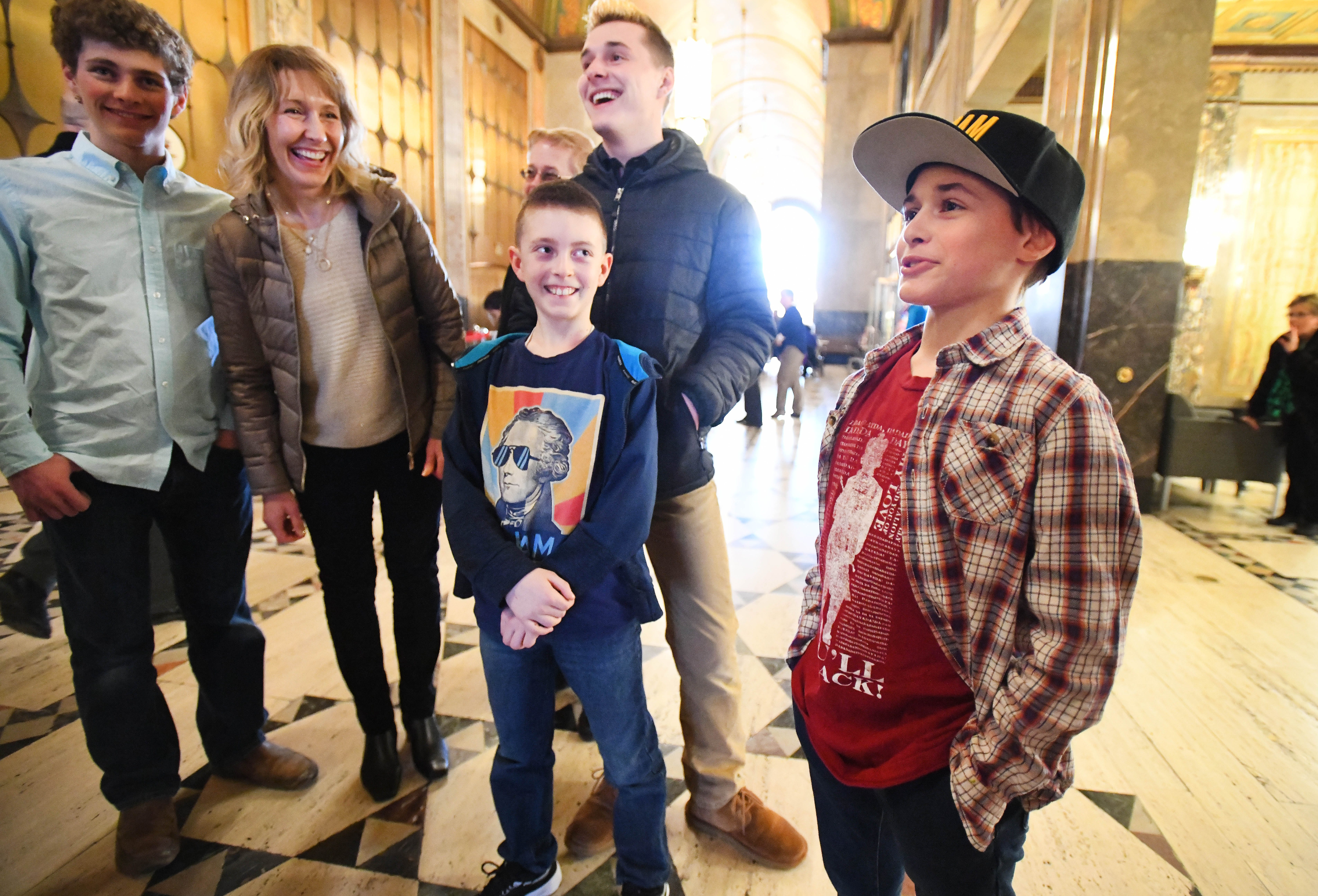 Wearing 'Hamilton' T-shirts, Ben Ruprecht, 10 and Adam Michaels, 12, who had a Hamilton themed birthday party, arrive with family and friends for the opening of the musical 'Hamilton' at the Fisher Theatre in Detroit, Michigan on March 12, 2019.