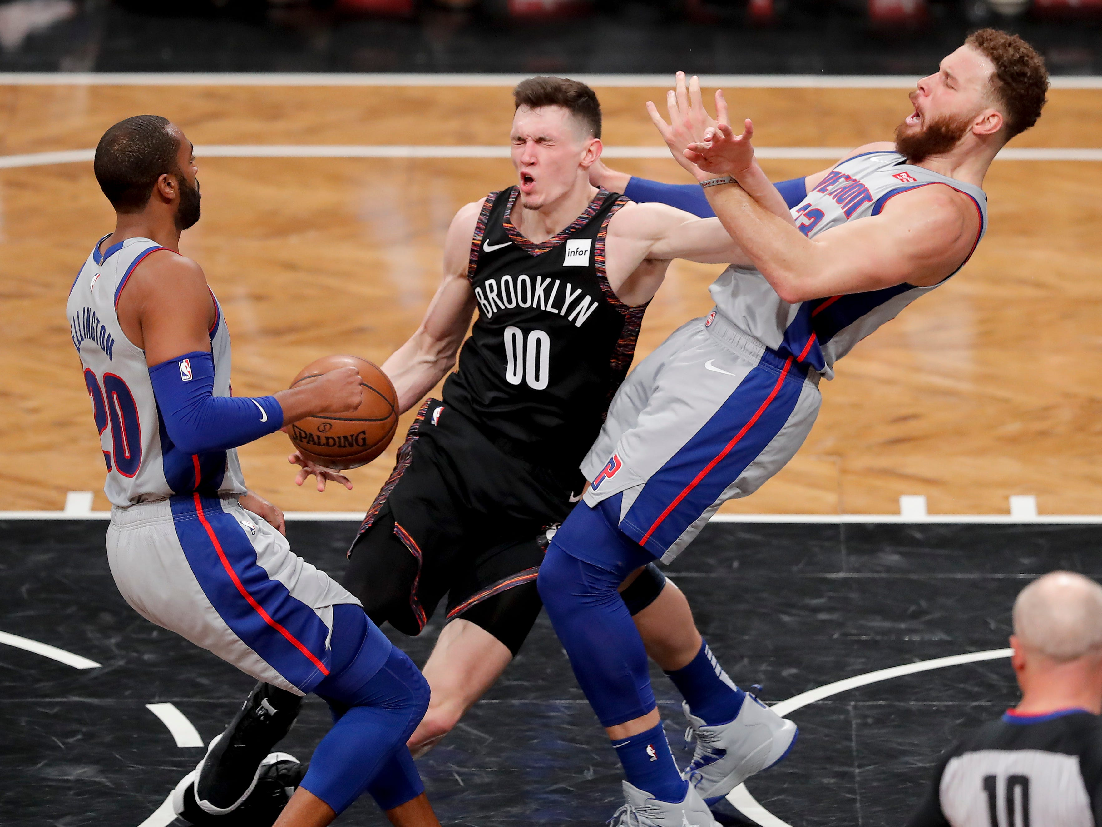 Brooklyn Nets forward Rodions Kurucs (00) charges into Detroit Pistons forward Blake Griffin (23) during the third quarter.