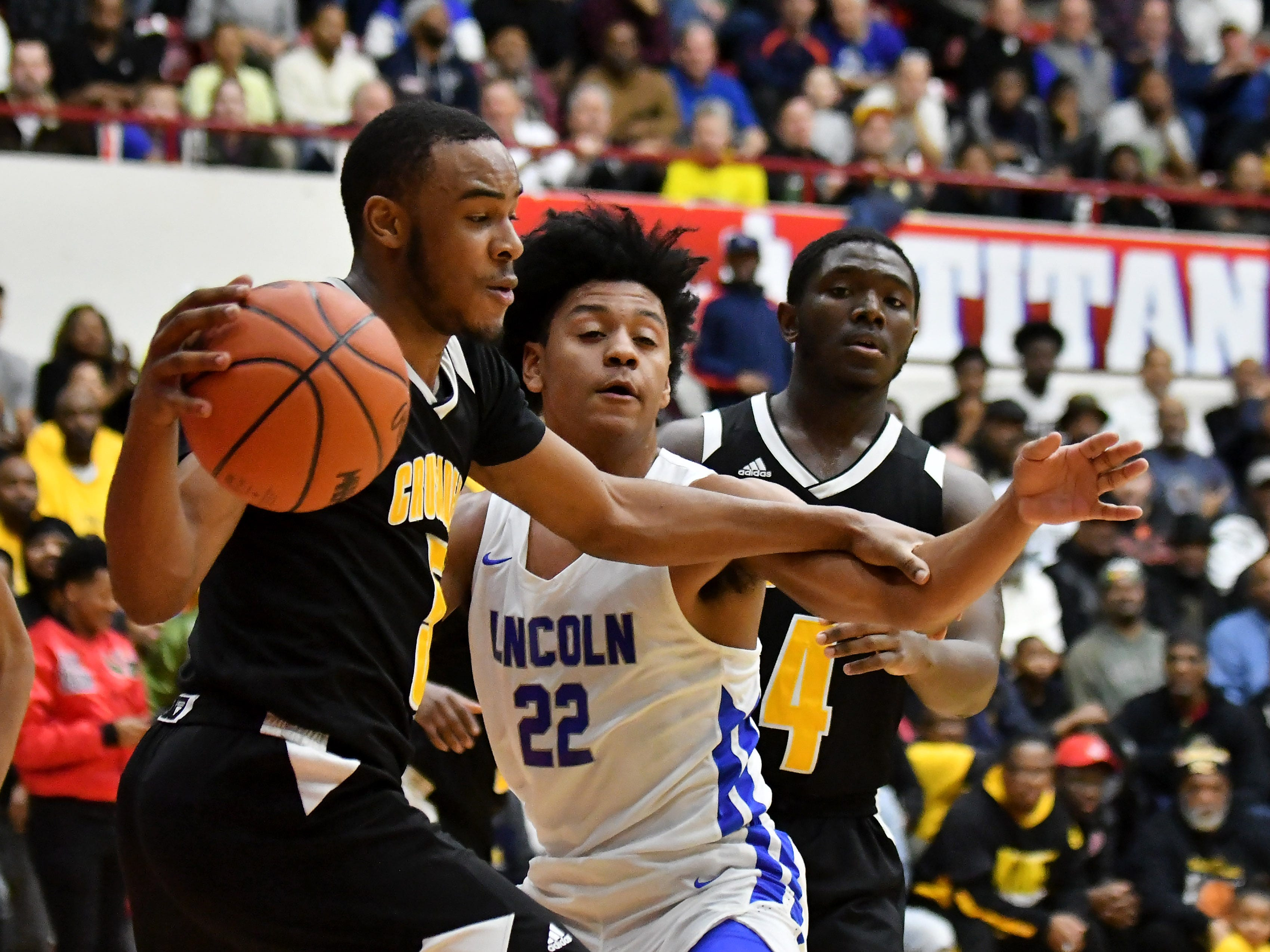 Lincoln's Ibn Abdul-Rahman (22) guards King's John Massey, Jr. in the last minute of the game in the second half.