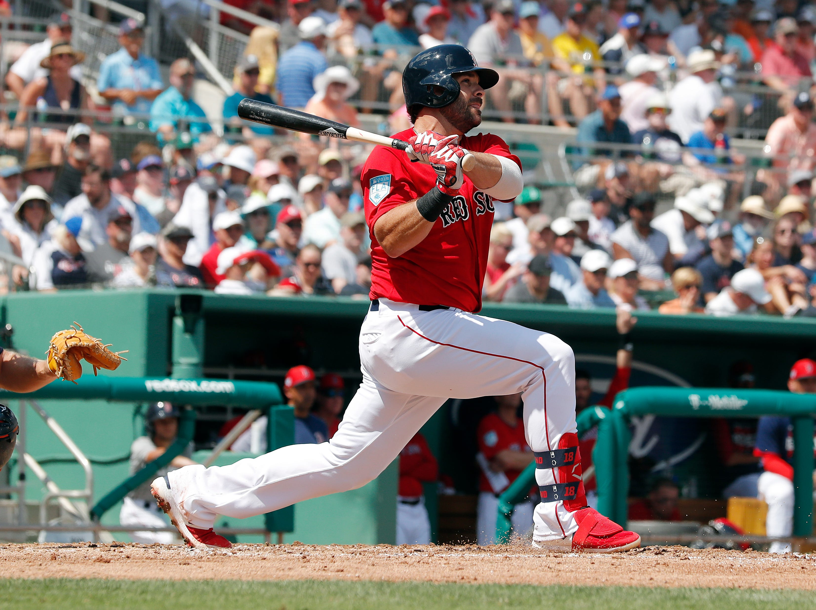 Boston Red Sox right fielder J.D. Martinez bats against the Tigers.