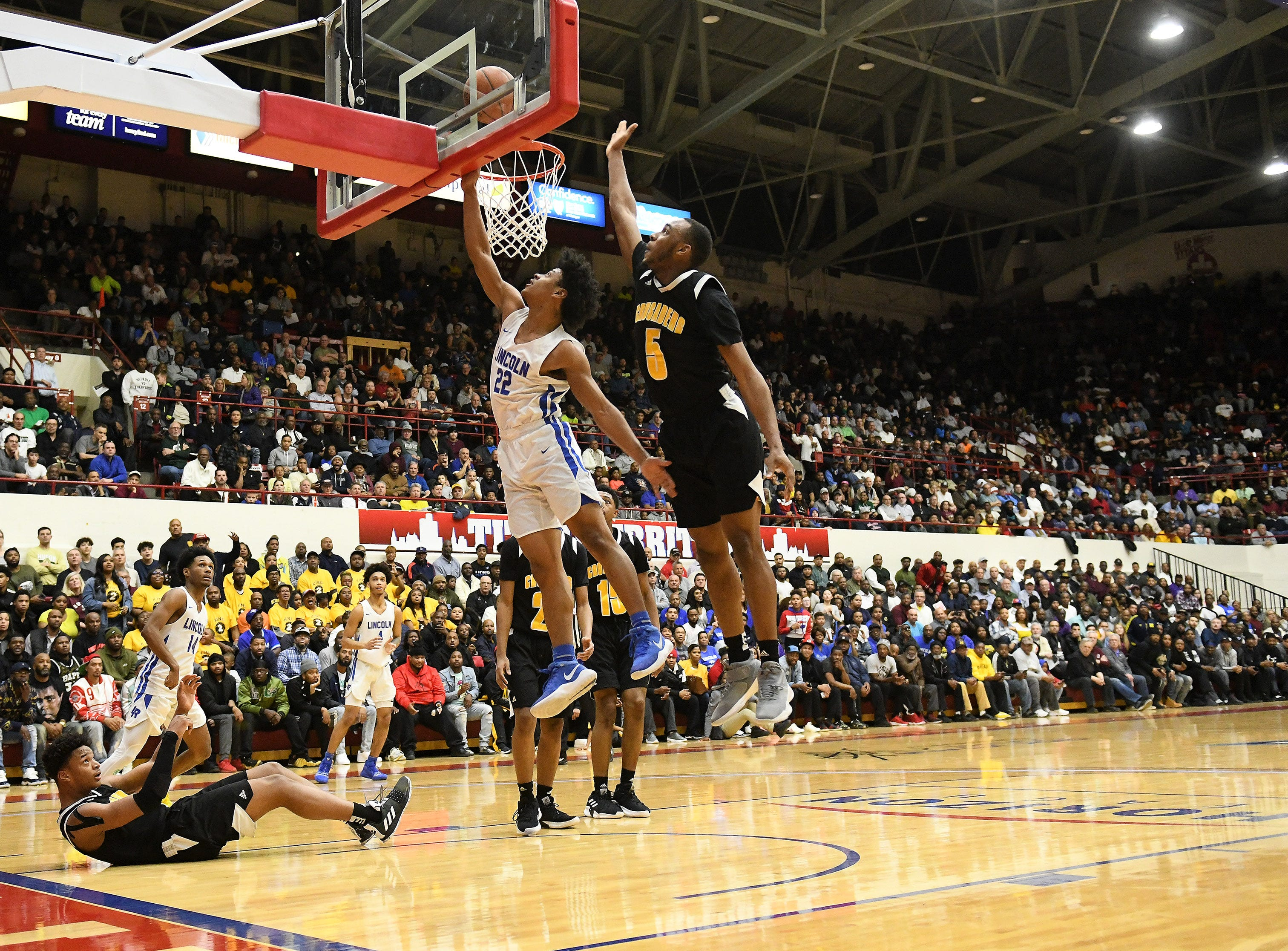 Lincoln's Ibn Abdul-Rahman (22) puts up a shot under King's John Massey, Jr. in the second half.