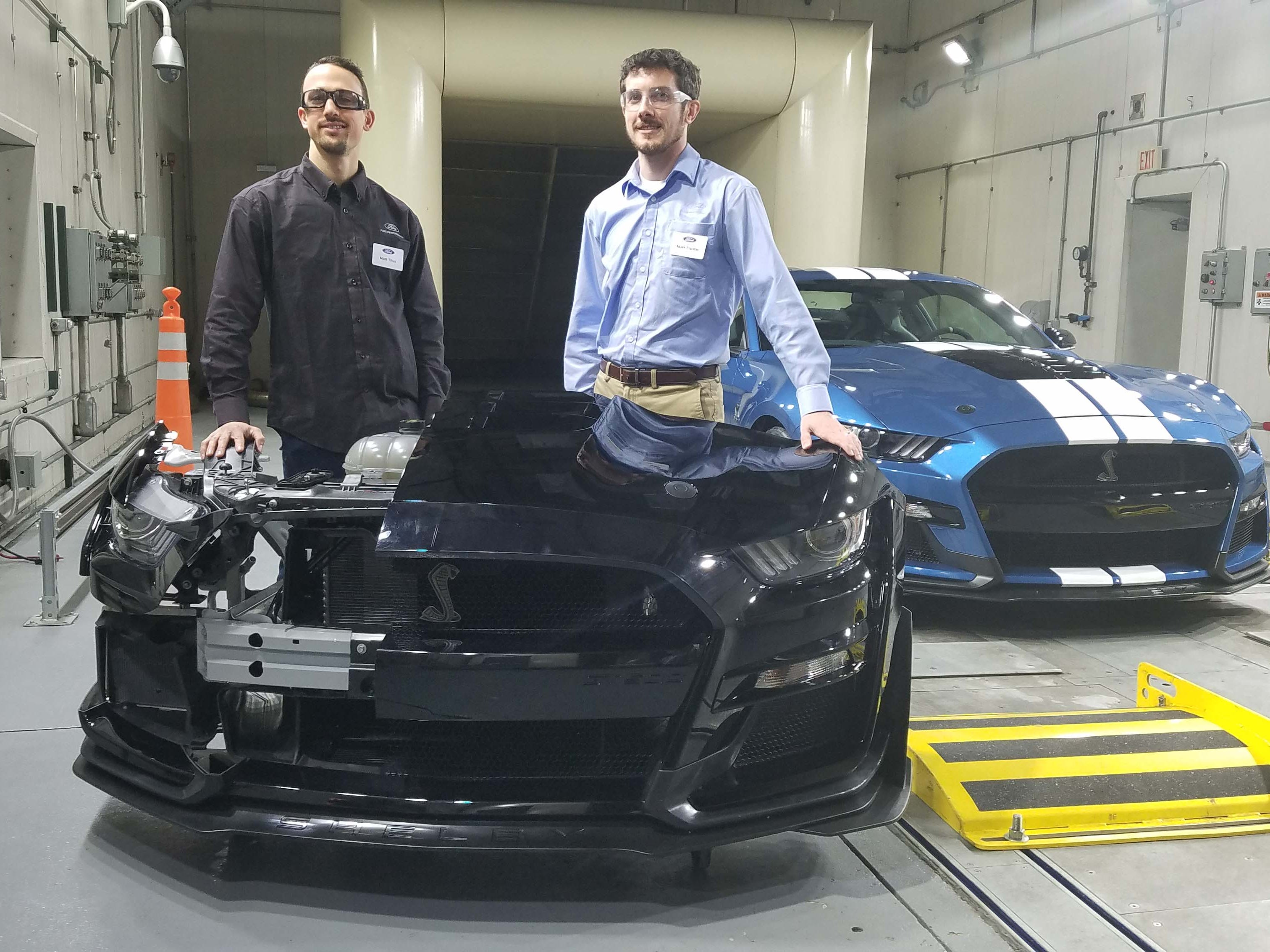 Ford Performance engineers Matt Titus (left) and Matt Trantor show off the unique front clip developed for the Ford Mustang GT500. The front clip contains 6 heat exchangers to cool the 700 hp engine behind it.