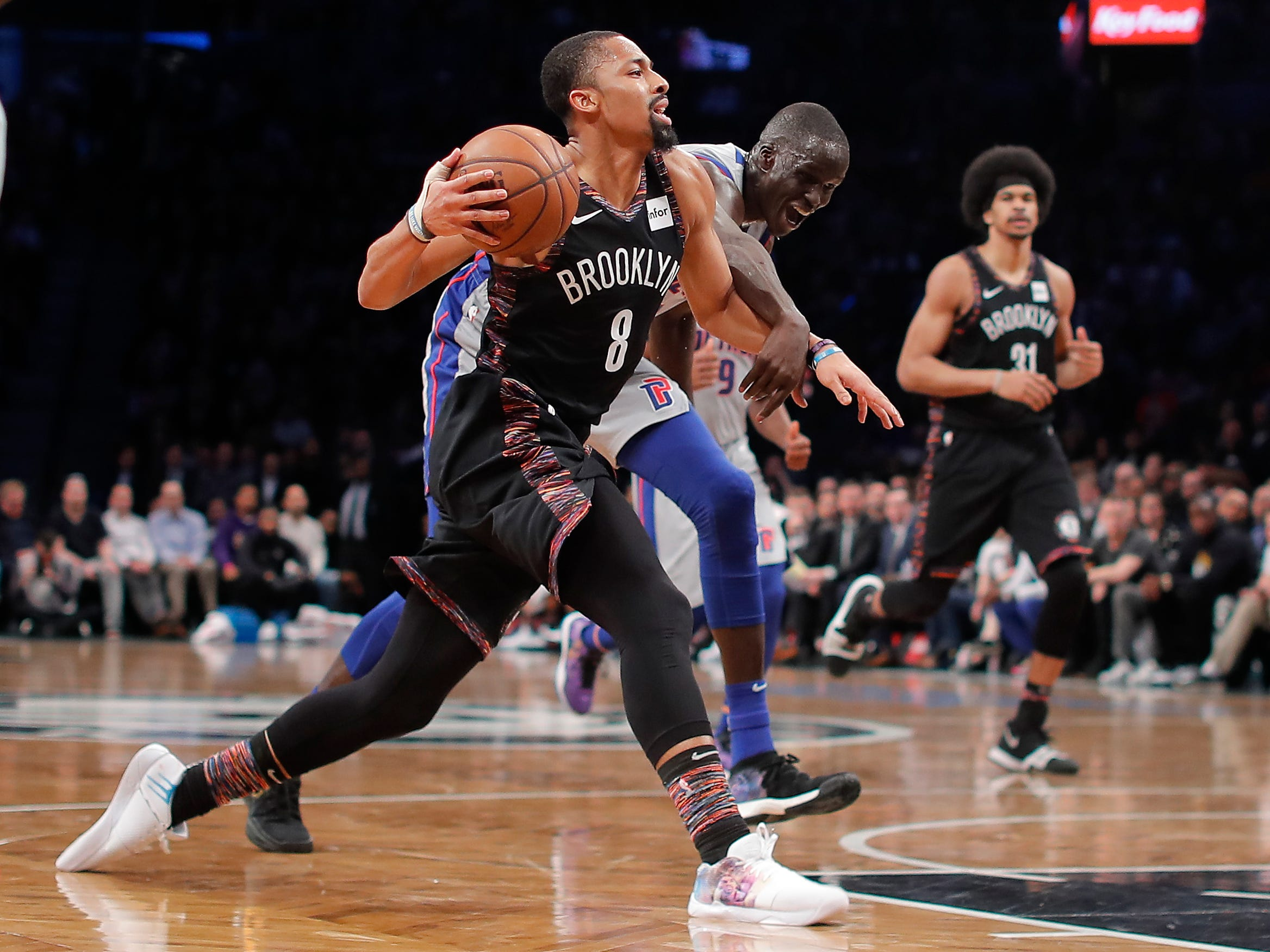Brooklyn Nets guard Spencer Dinwiddie (8) is fouled as he drives against Detroit Pistons forward Thon Maker (7) during the fourth quarter.