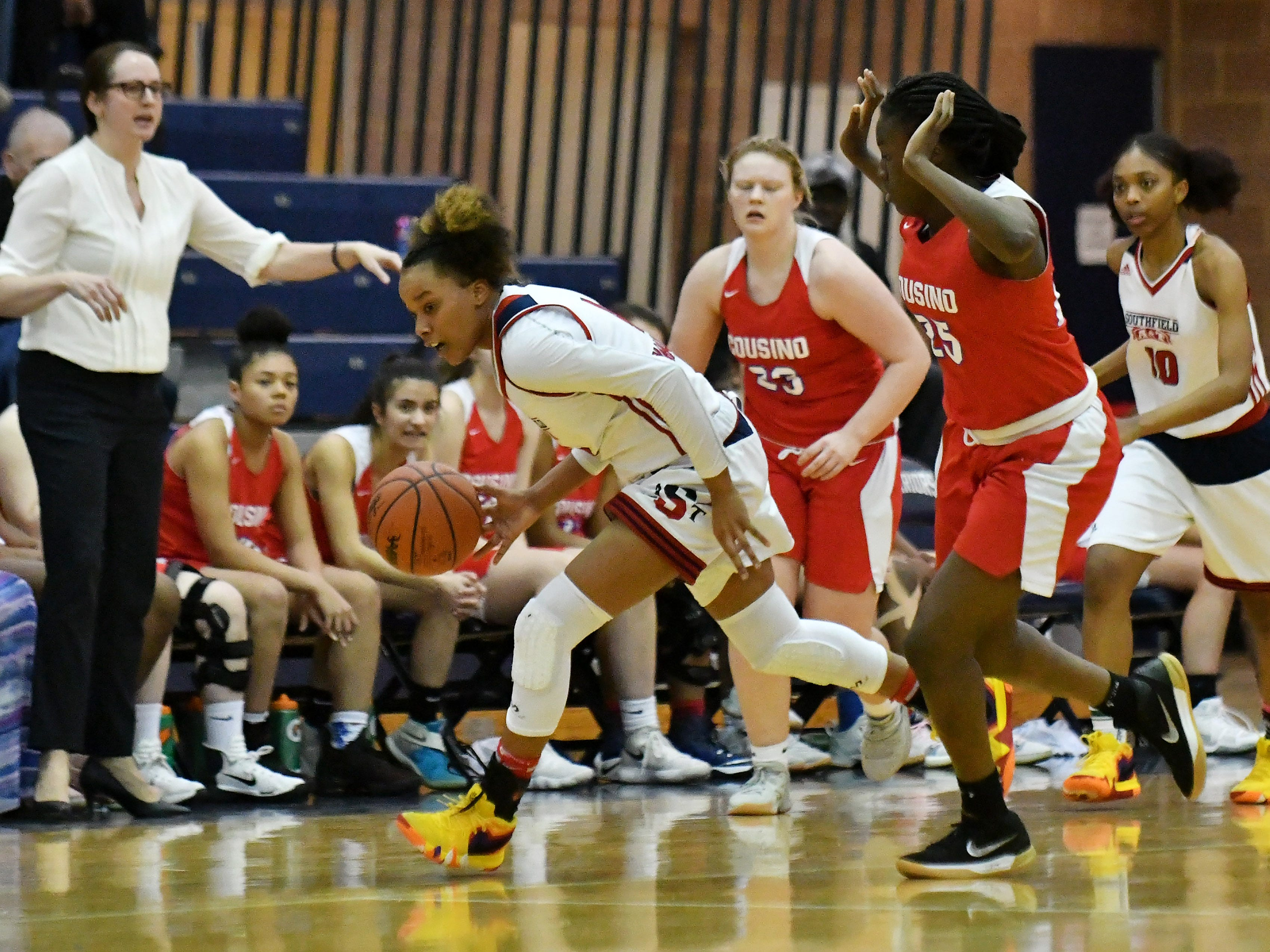Warren Cousino's Rachael Adewusi tries not to foul Southfield A&T's Soleil Barnes, left, in the second half.