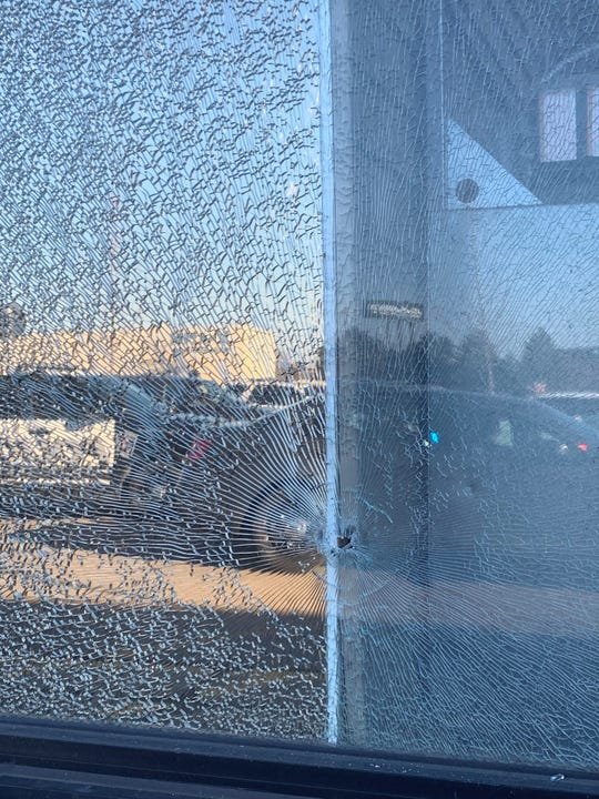 A bullet shattered part of a front window at the Home Depot.