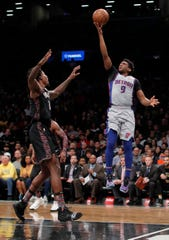 Detroit Pistons guard Langston Galloway puts up a shot against Brooklyn Nets forward Ed Davis during the first quarter Monday night.