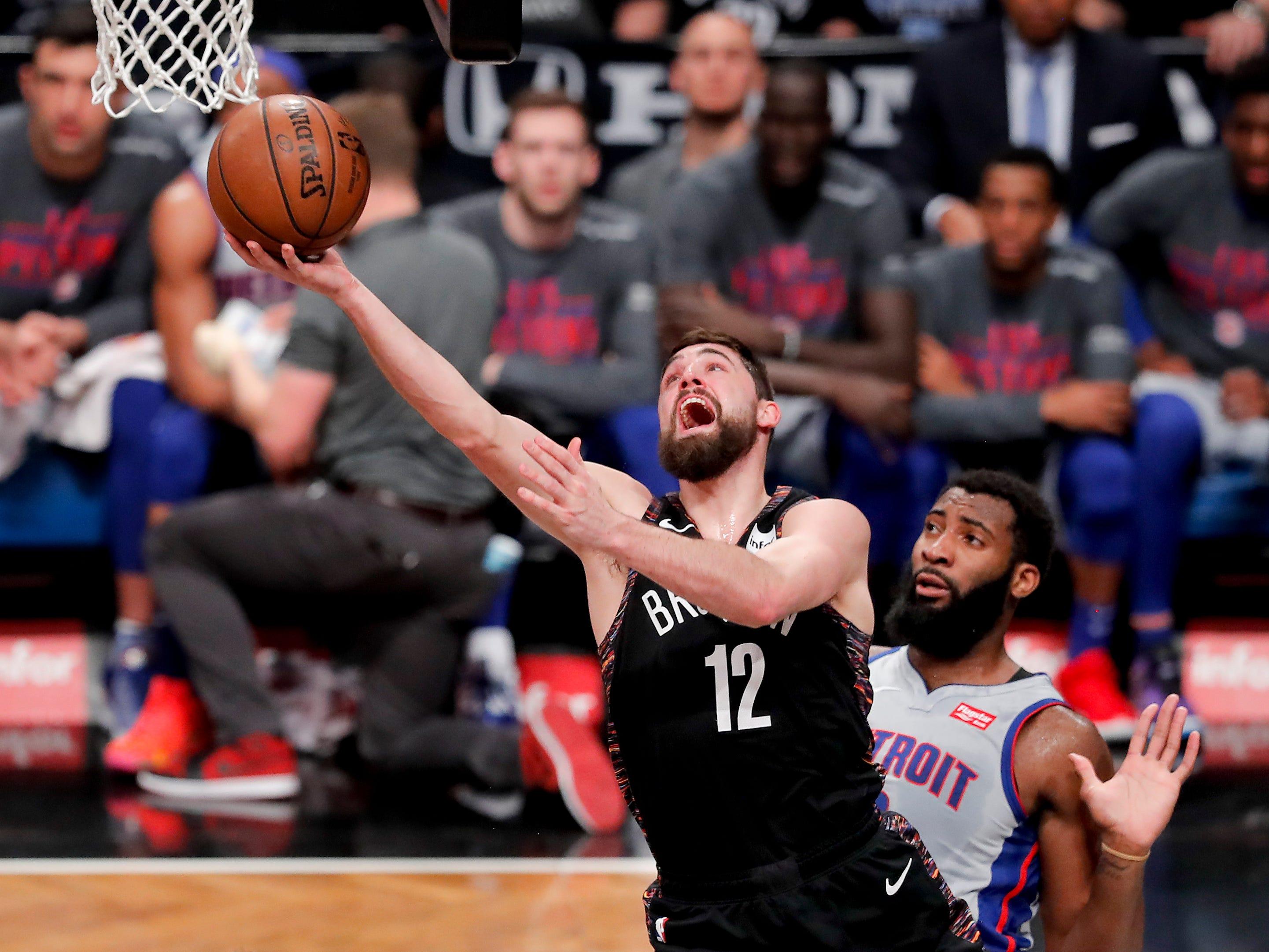 Brooklyn Nets forward Joe Harris (12) puts up a shot against Detroit Pistons center Andre Drummond (0) during the third quarter.