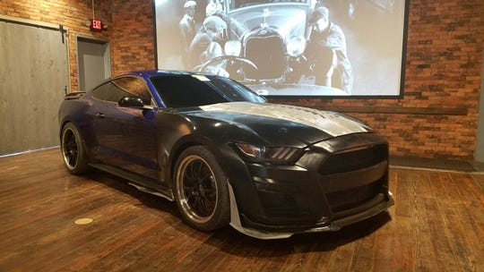 """The Buck. Before a Mustang GT500 prototype was made, engineers 3D-printed parts, then added them to this Mustang GT """"Buck"""" - or mule - to test aerodynamic demands in the wind tunnel."""