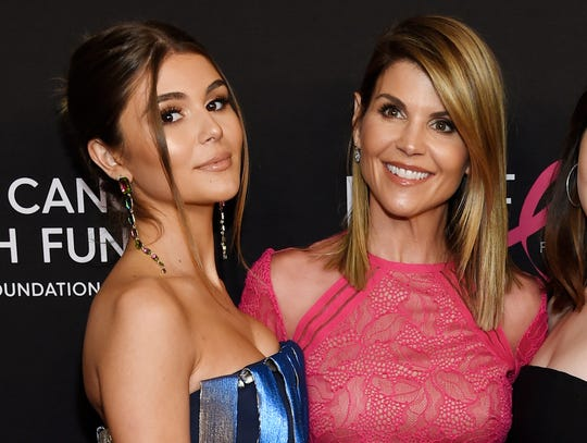Actress Lori Loughlin and daughter Olivia Jade Giannulli, left.  Loughlin and her husband allegedly gave $500,000 to have their two daughters labeled as recruits to the USC crew team, even though neither participated in the sport. Their 19-year-old daughter Olivia Jade Giannulli, a social media star with a popular YouTube channel, attends USC.