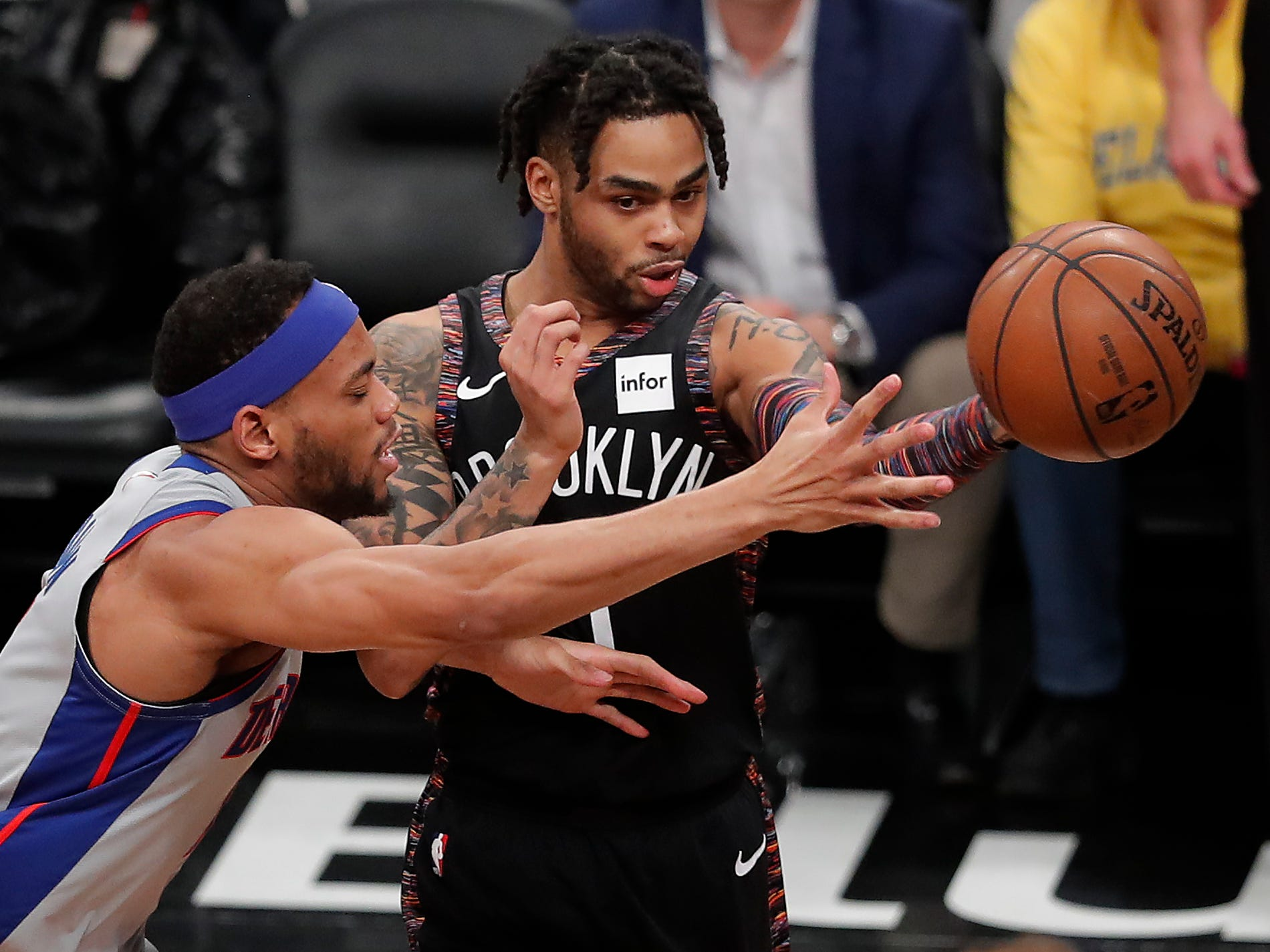 Brooklyn Nets guard D'Angelo Russell (1) passes the ball against Detroit Pistons guard Bruce Brown (6) during the third quarter.
