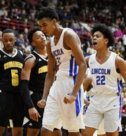 Lincoln's Emoni Bates and Ibn Abdul-Rahman react in the fourth quarter. Bates finished with 17 points and 10 rebounds in a 56-52 victory over Detroit King Tuesday in a Division 1 quarterfinal game at Calihan Hall.