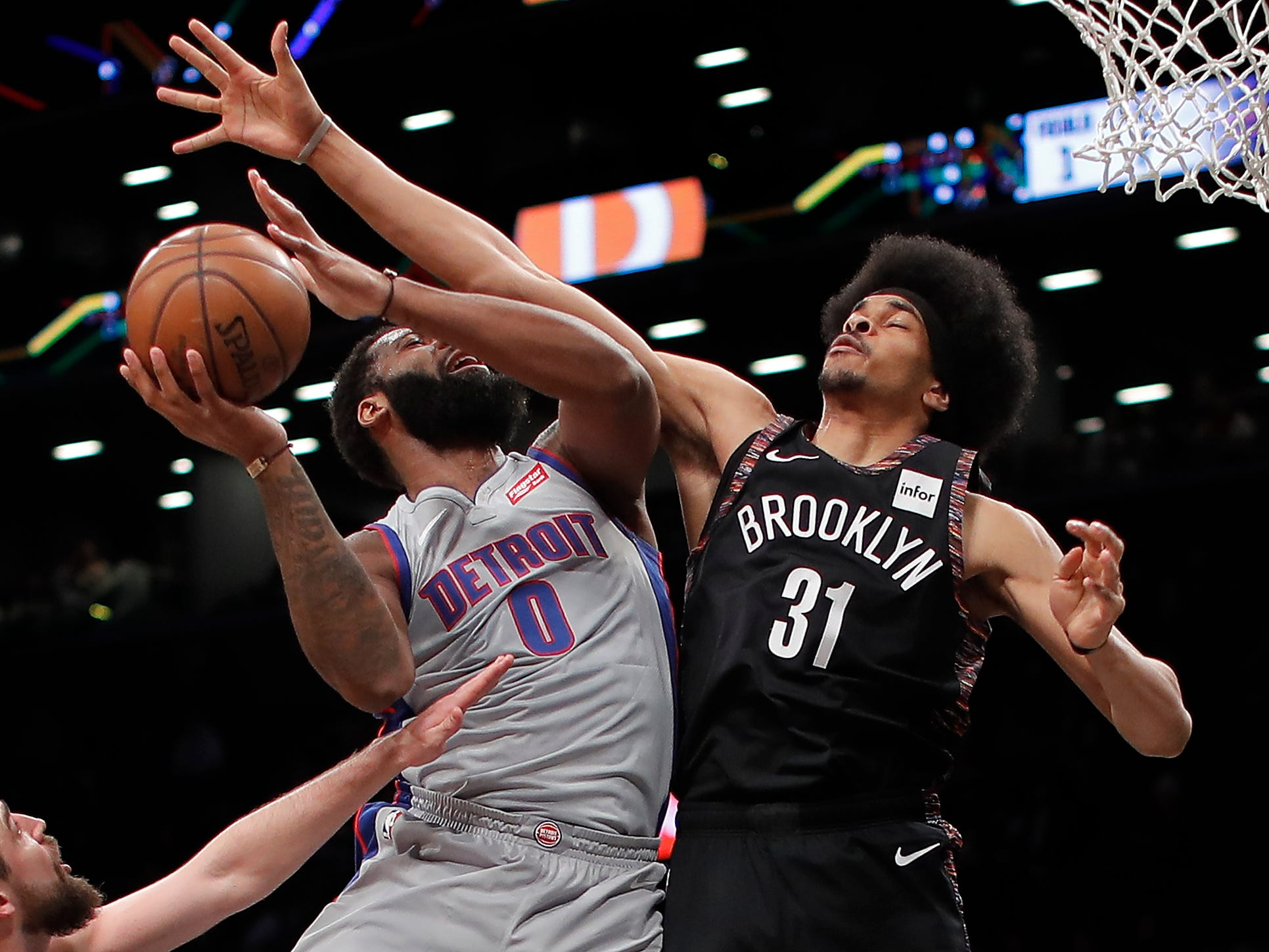 Detroit Pistons center Andre Drummond (0) puts up a shot against Brooklyn Nets center Jarrett Allen (31) during the first quarter, Monday, March 11, 2019, in New York.