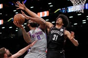 Detroit Pistons center Andre Drummond (0) puts up a shot against Brooklyn Nets center Jarrett Allen (31) during the first quarter.