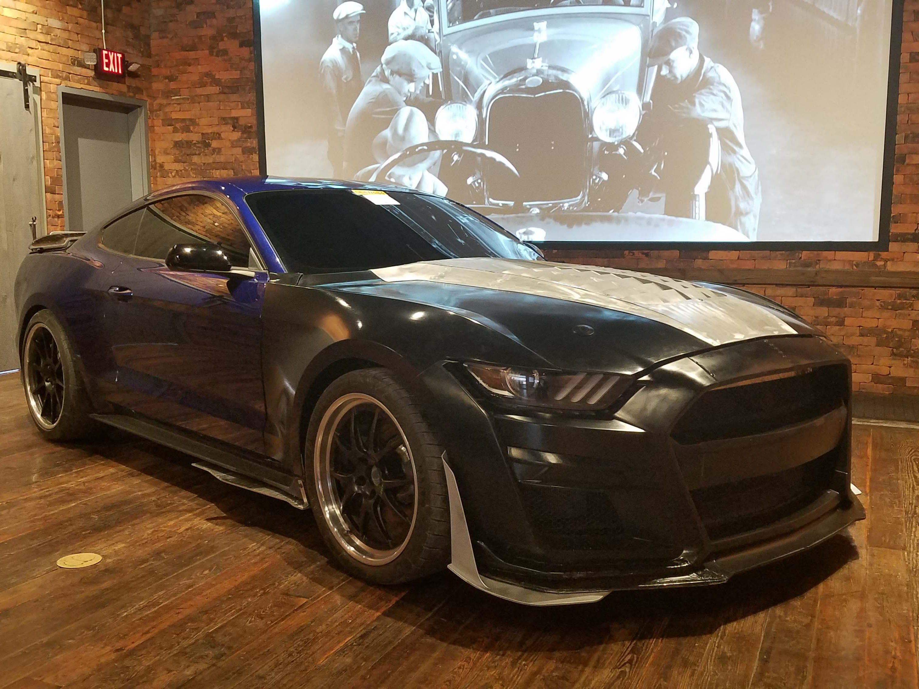 """The Buck. Before a Mustang GT500 prototype is ever made, engineers 3D-printed parts then added them to this Mustang GT """"Buck"""" - or mule - to test aerodynamic demands in the wind tunnel."""