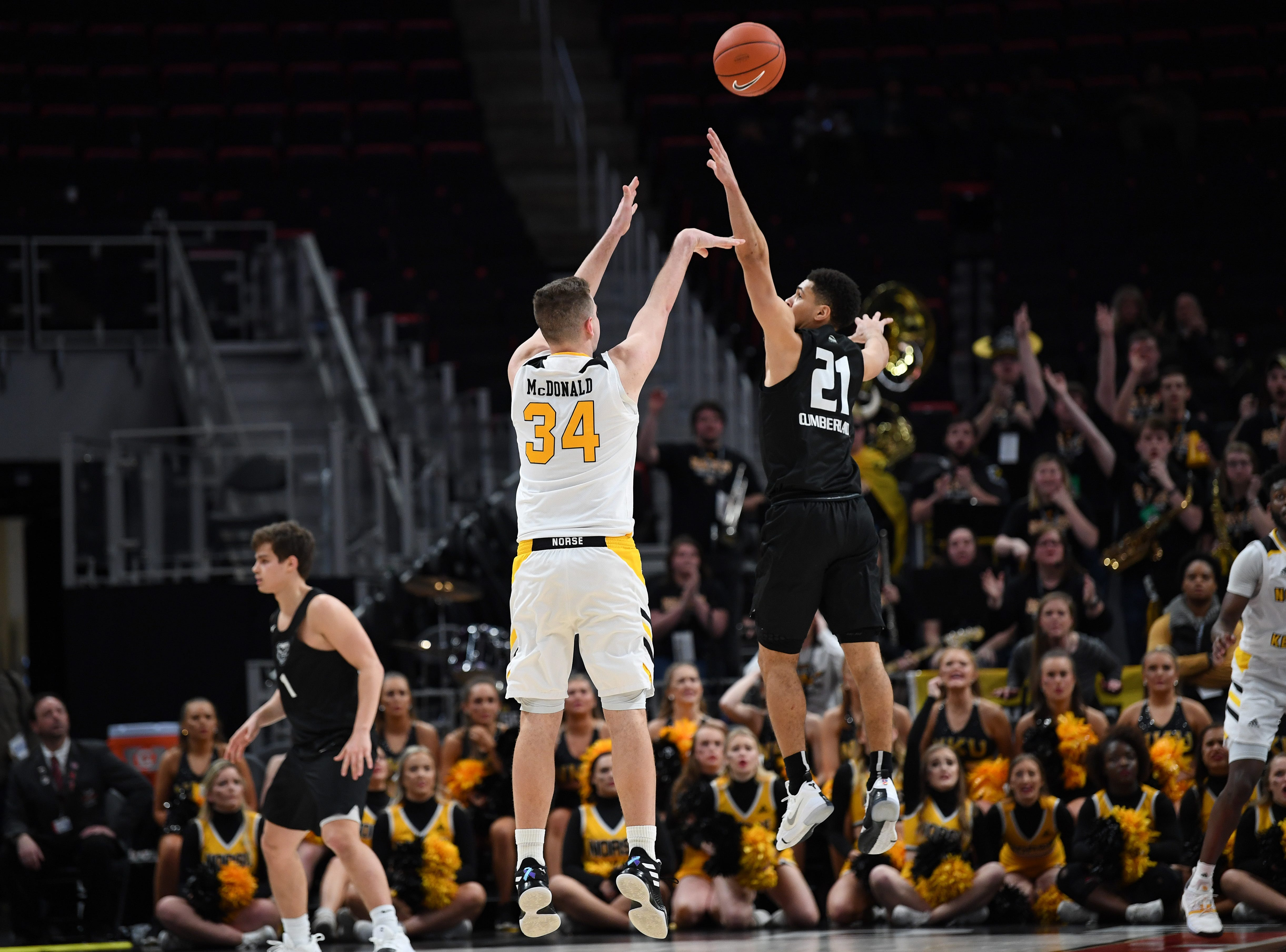 Northern Kentucky Norse forward Drew McDonald, left, makes the game winning shot, 64-63, against the Oakland Golden Grizzlies near the end of the second half of their Horizon League semifinal game at Little Caesars Arena in Detroit, Monday, Mar. 11, 2019.  Northern Kentucky defeated Oakland 64-63.
