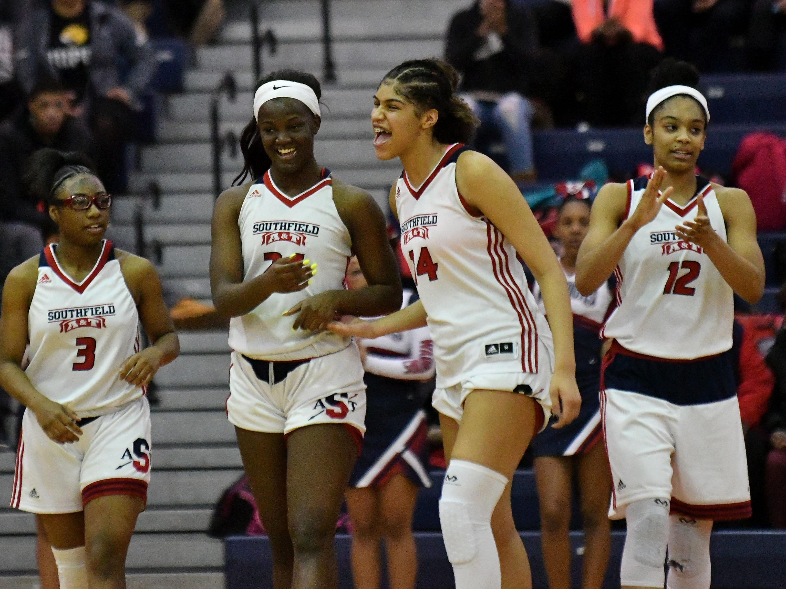 Southfield A&T teammates, from left, Kayiona Willis (3), Alexis Johnson (24), Jasmine Worthy (14) and Cheyenne McEvans are happy after a technical foul is called on Warren Cousino in the first half.