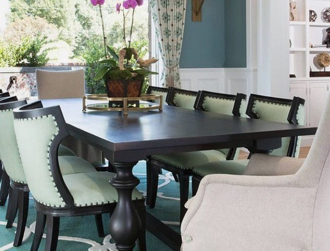 Fresh flowers, like orchids in the center of this dining room table, bring any room to life.