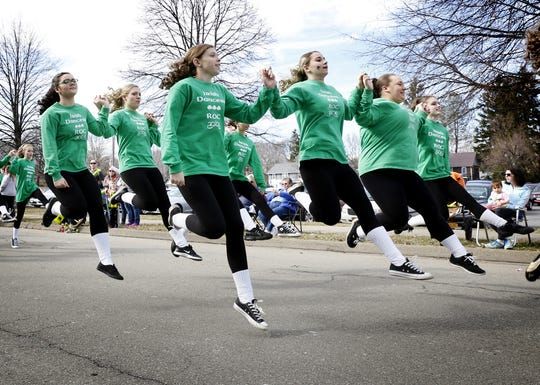 ROC Irish Dancers leap while doing a jig near Horseheads High School in the Horseheads St. Patrick's Day Parade  in 2016.