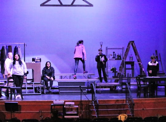 """Members of the Notre Dame High School theater department rehearse a scene for the upcoming performance of the play """"Our Town."""""""