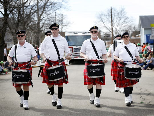 The Grenadiers Alumni Drum Line marches down Sayre Street while rattling off a cadence at the Horseheads St. Patrick's Day Parade in 2016.