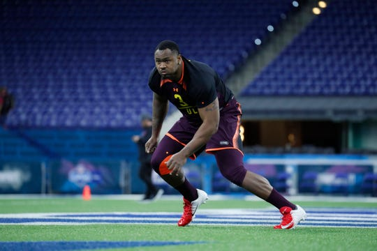 Florida State defensive tackle Demarcus Christmas goes through workout drills during the 2019 NFL Combine at Lucas Oil Stadium.