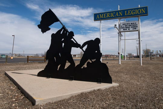 A steel silhouette depicting the raising of the American flag at Iwo Jima decorates the parking lot of American Legion George Beach Post No. 4 along County Road 54G near Laporte.