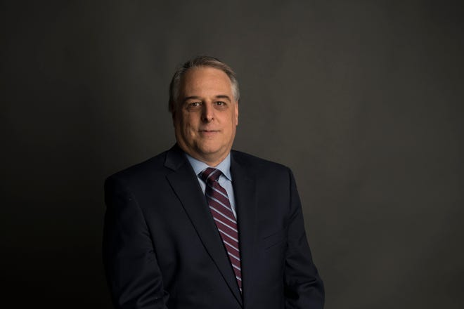 Fort Collins mayoral candidate Michael Pruznick poses for a portrait on Friday, March 8, 2019, at The Coloradoan in Fort Collins, Colo.