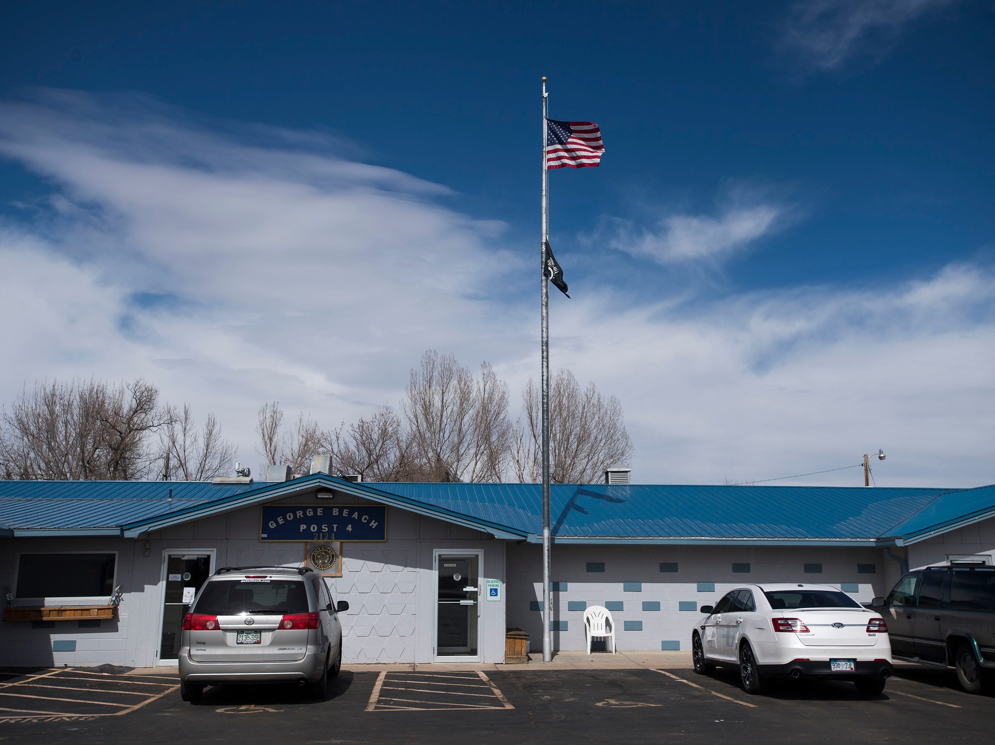 The U.S. flag and POW/MIA flag fly above the entrance on Tuesday, March 12, 2019, at the American Legion Post Four in Fort Collins, Colo.
