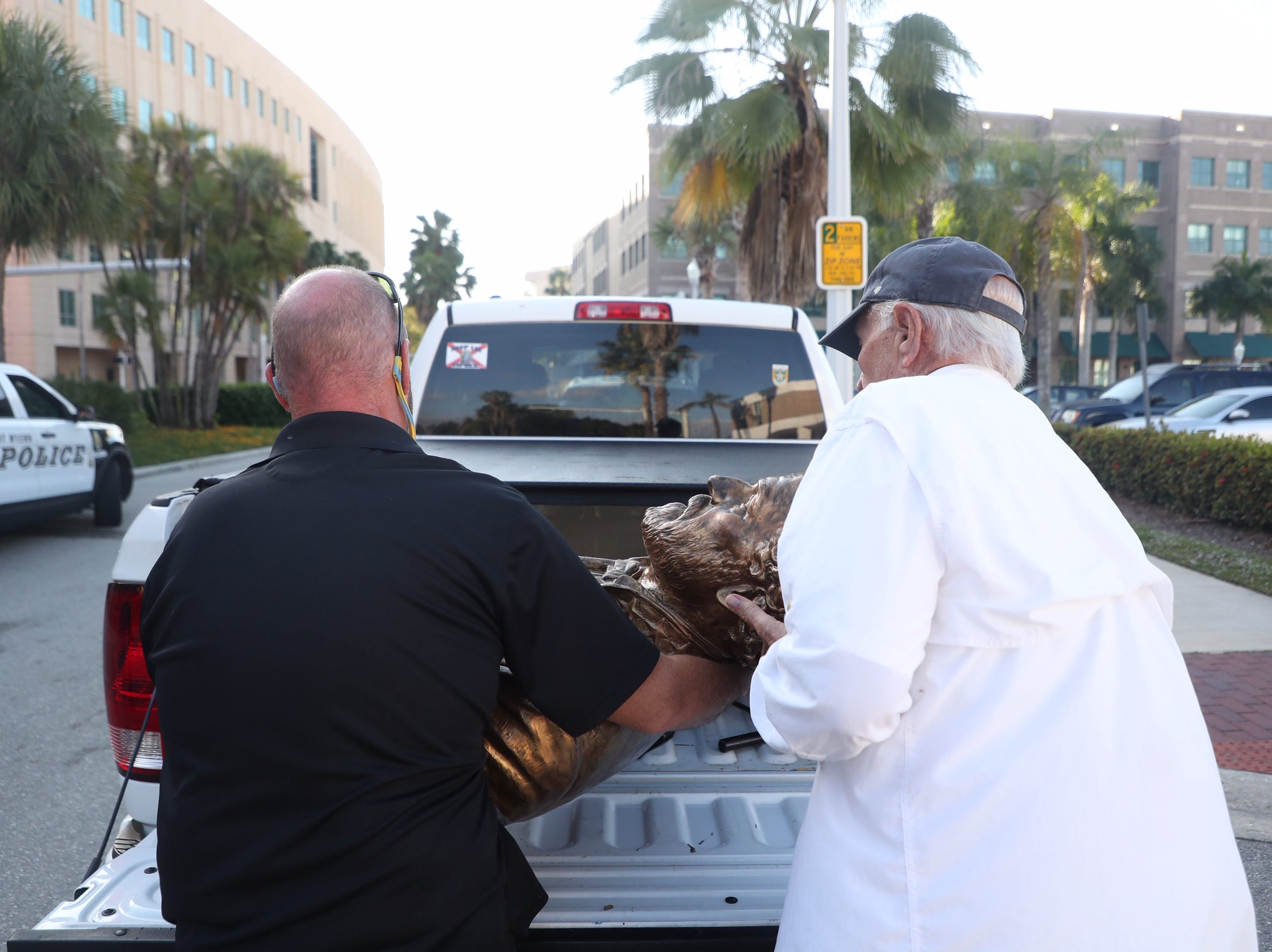 Members of the Sons of Confederate Veterans placed the Robert E. Lee bust in the back of a vehicle in downtown Fort Myers on Tuesday, March 12, 2019.