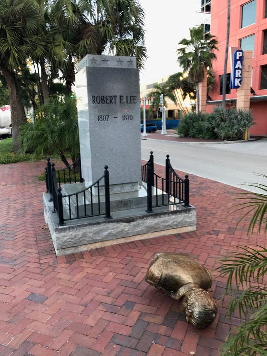 The bust of Confederate Gen. Robert E. Lee was lying on the ground in front of its pedestal in downtown Fort Myers on Tuesday, March 12, 2019.