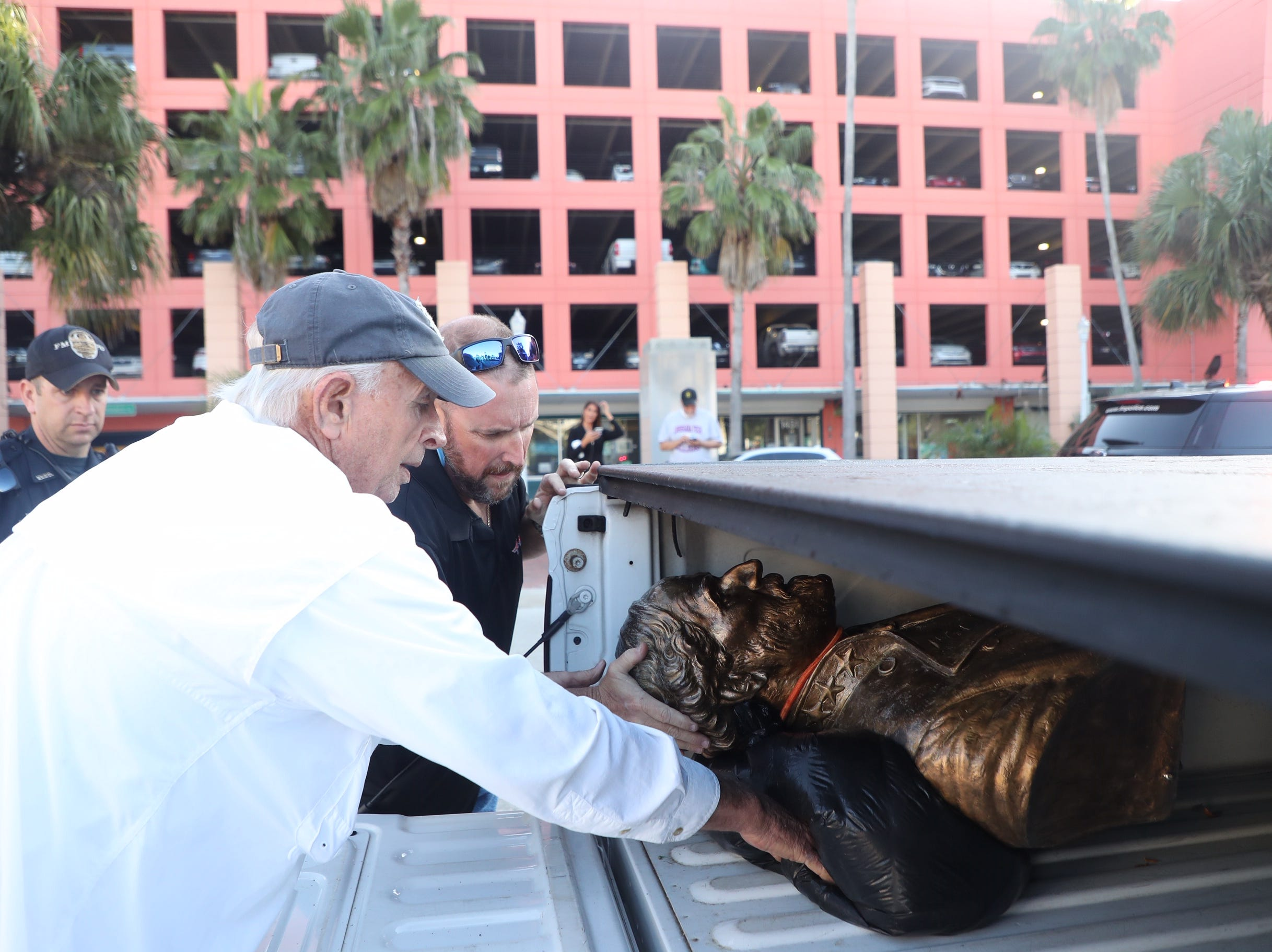 Members of the Sons of Confederate Veterans placed the Robert E. Lee bust in the back of a vehicle in downtown Fort Myers. It is unclear what will happen to the monument.