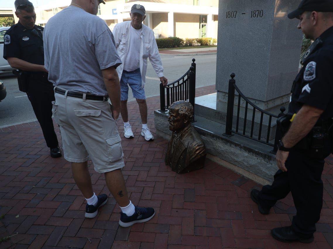 The bust of Robert E. Lee in downtown Fort Myers was found face down on Tuesday 3/12/2019 morning. Fort Myers Police are investigating. Members of the Sons of Confederate Veterans transferred the bust to the back of a vehicle and driven away.