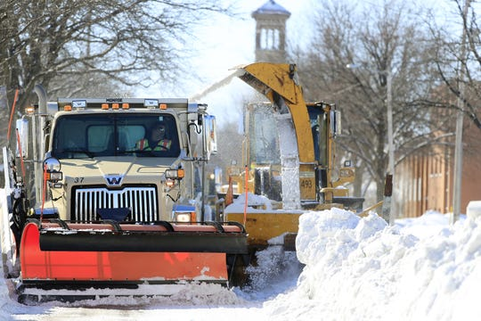 Crews remove piles of snow from downtown Green Bay streets on Feb. 13.
