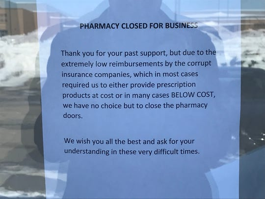 Lineville Health Mart posted this sign on its front door after closing abruptly on March 11. The pharmacy is trying to find another pharmacy to accept its patient records.
