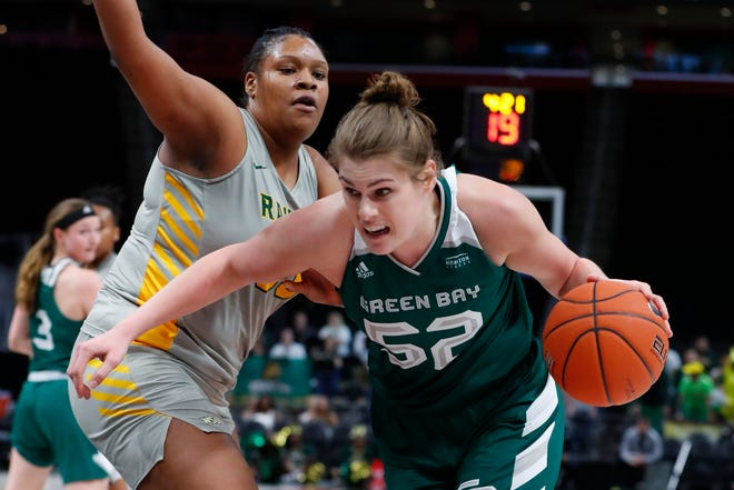 UW-Green Bay center Madison Wolf (52) drives on Wright State center Tyler Frierson in the second half of the Horizon League title game Tuesday in Detroit.