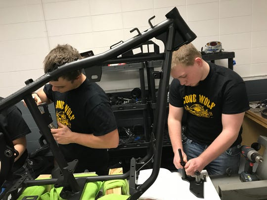 Algoma High School senior Gaven Jones and junior McKale Krueger work on parts for the school's Biker Build Off project for the Northeast Wisconsin Motorama.