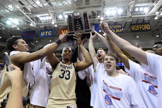 Wofford celebrates its 70-58 win over UNC-Greensboro for the Southern Conference tournament championship, Monday, March 11, 2019, in Asheville, N.C. Wofford defeated UNC-Greensboro 70-58. (AP Photo/Kathy Kmonicek)