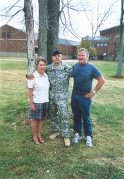Atkins' parents, Jack and Elaine Atkins of Bozeman, visit then-Sgt. Travis Atkins at Fort Drum, N.Y., in 2006.