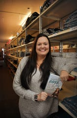 """Jessi Robertsholds her book, """"Backroads Boss Lady,"""" just out this month.  She plans to speak about her book and her brand, which can sometimes be, """"heavy on sass,"""" and offers mentorship to, """"small town women business owners,"""" during her keynote speech at the Great Western Show on March 21."""