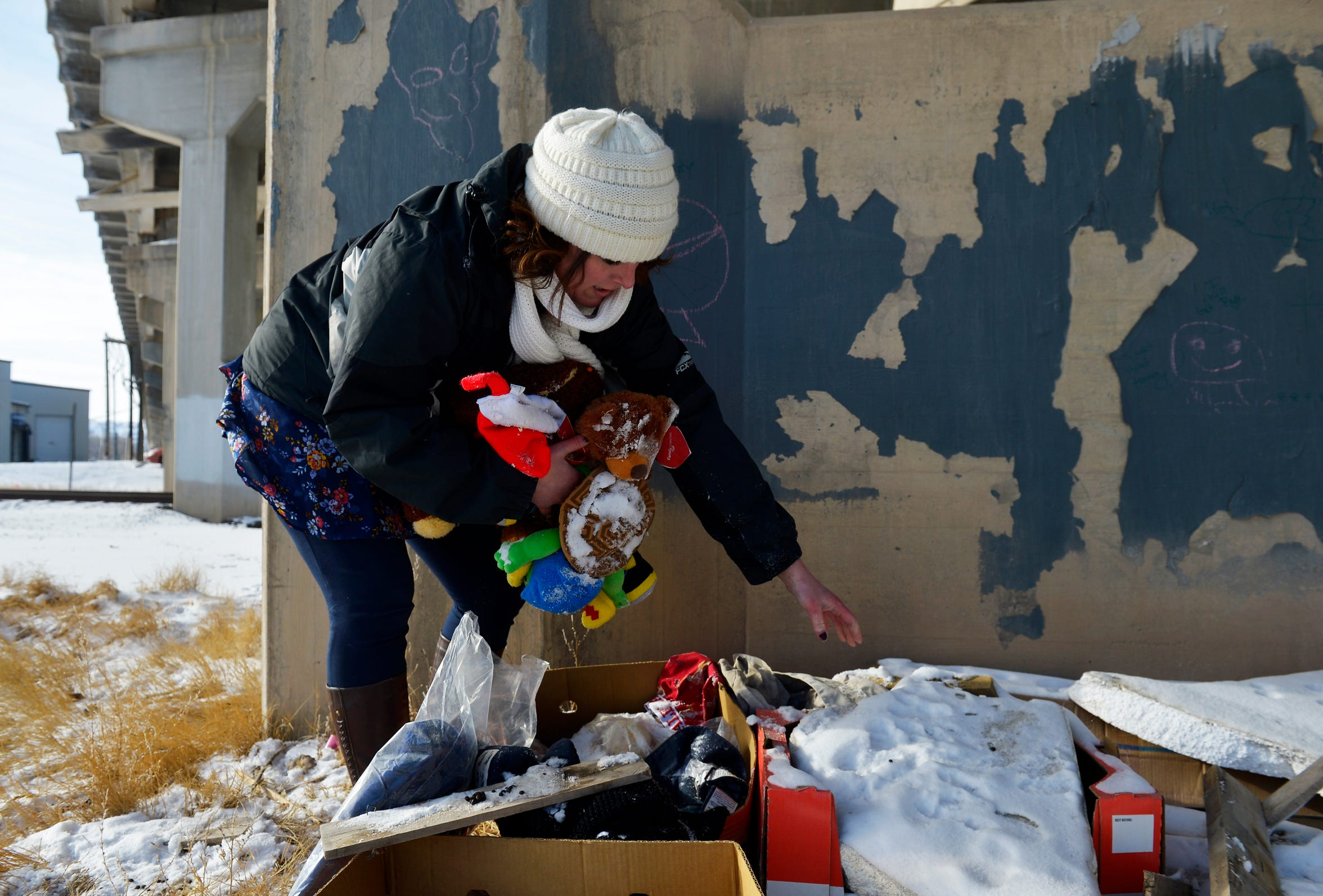 Jennifer Lehman, homeless outreach coordinator for St. Vincent de Paul, collects Barbara Snider's belongings from under the 10th Avenue South overpass.  Barbara Snider was a homeless woman who was living underneath the overpass until her death in early January of this year.