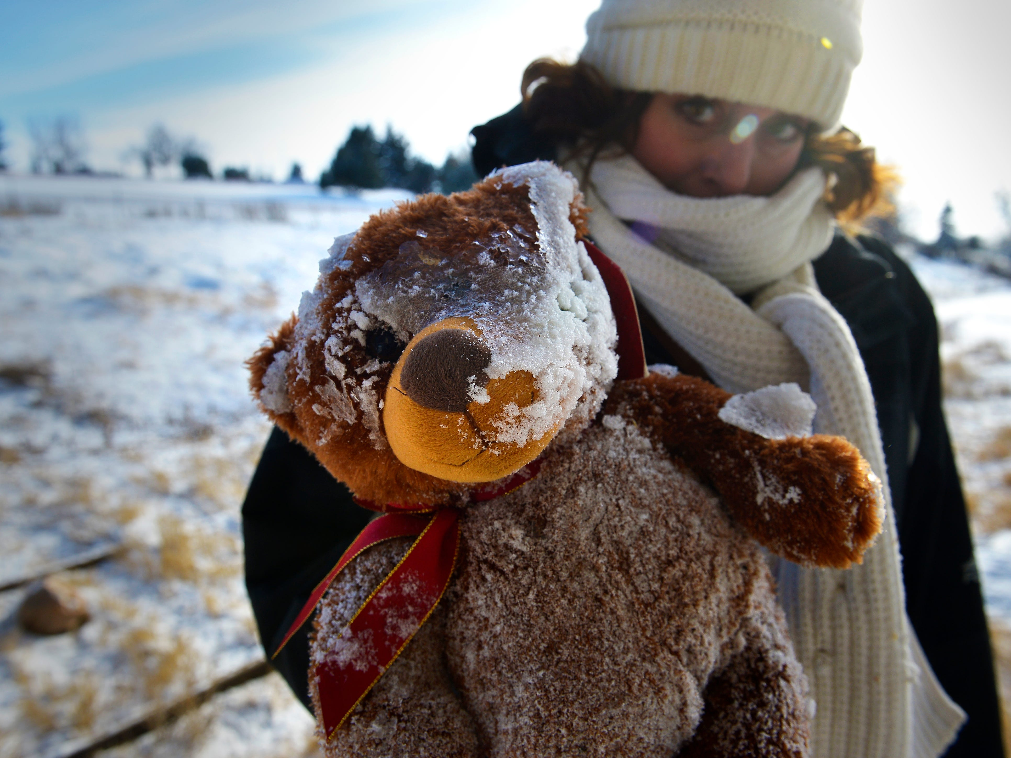 Jennifer Lehman, homeless outreach coordinator for St. Vincent de Paul, holds up a stuffed bear she believes belonged to Barbara Snider, a homeless woman who was found dead on Jan. 5 under the 10th Avenue South overpass.  Many of Barbara's belongings remained beneath the underpass over a month after her passing.