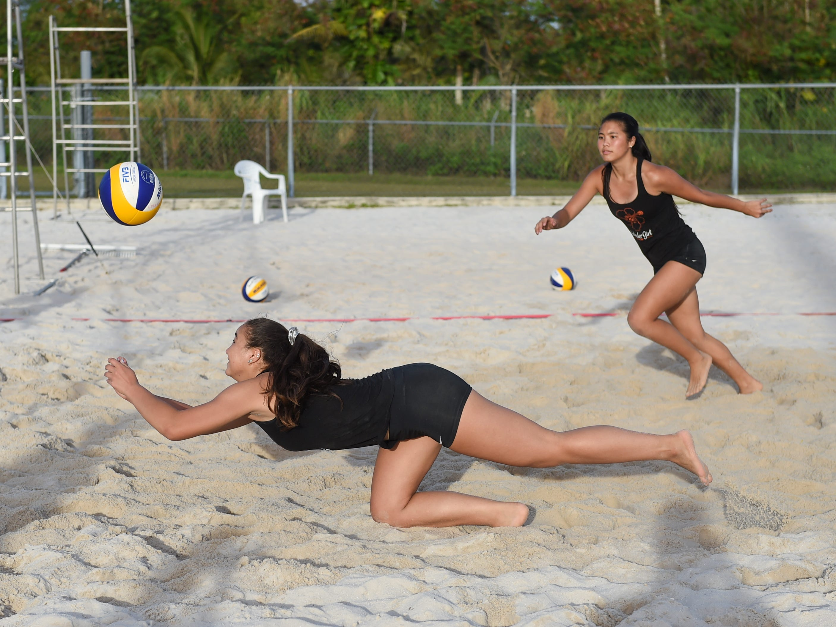 Tylee Shepherd digs during the IIAAG Beach Volleyball championship game at the Guam Football Association National Training Center in Dededo, March 12, 2019.