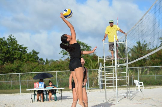St. John's player Hallie Wigsten rises for a spike during the IIAAG Beach Volleyball championship game at the Guam Football Association National Training Center in Dededo, March 12, 2019.