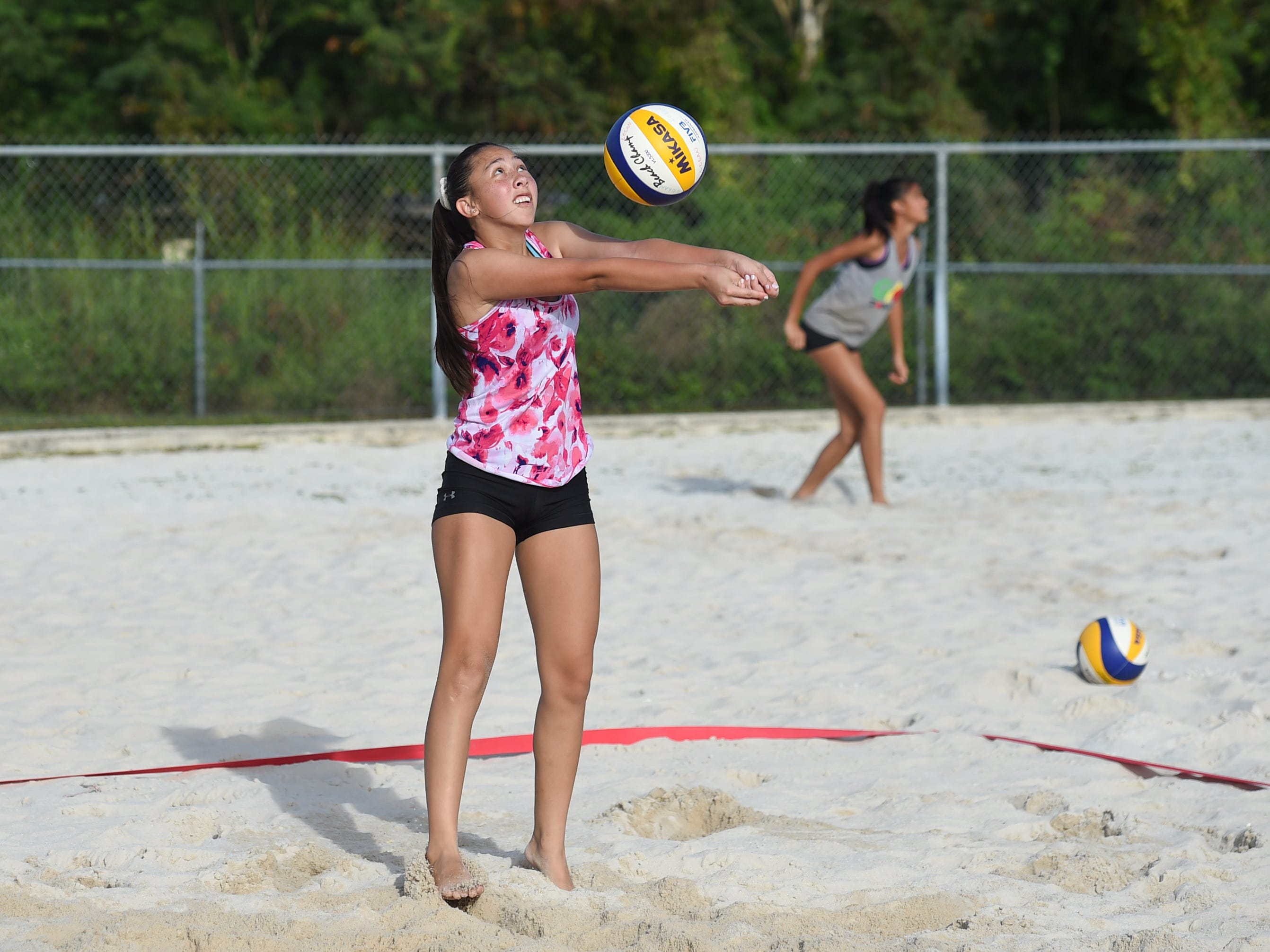 St. John's player Elisabeth Errett keeps the ball up during the IIAAG Beach Volleyball third place game at the Guam Football Association National Training Center in Dededo, March 12, 2019.