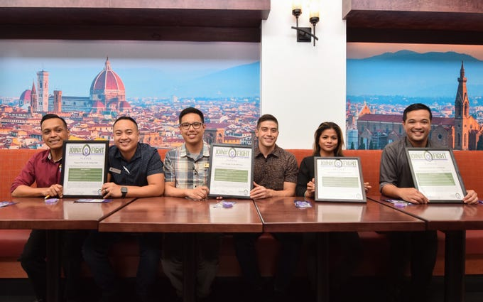 Representatives from Guam restaurants display their signed Guam Cancer Care's Join the Fight pledges at Olive Garden in Tumon, March 12, 2019. From right: Paolo Dizon, Olive Garden general manager, Jenny Aguigui, Applebee's general manager, Champ Camacho, Pieology Pizzeria regional manager, Daniel Jesus, IHOP Tamuning general manager, Ed Estillore, Pieology Pizzeria restaurant manager, and Daryl Rubrico, IHOP Tumon general manager.